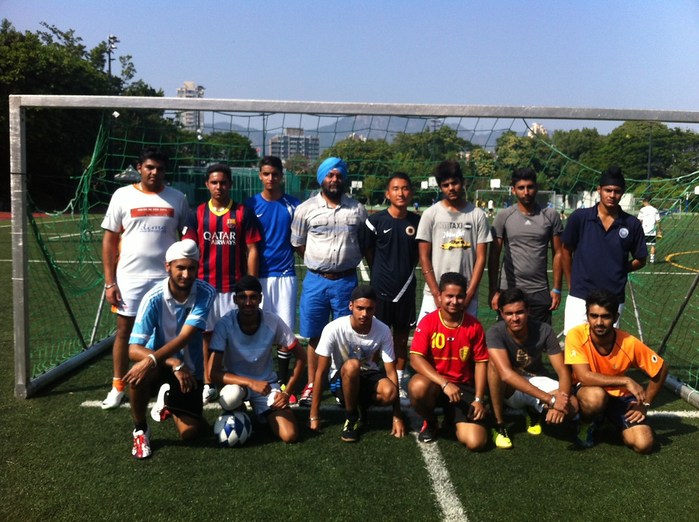 Group photo with Indian community group who were put through their paces by coach Kenji