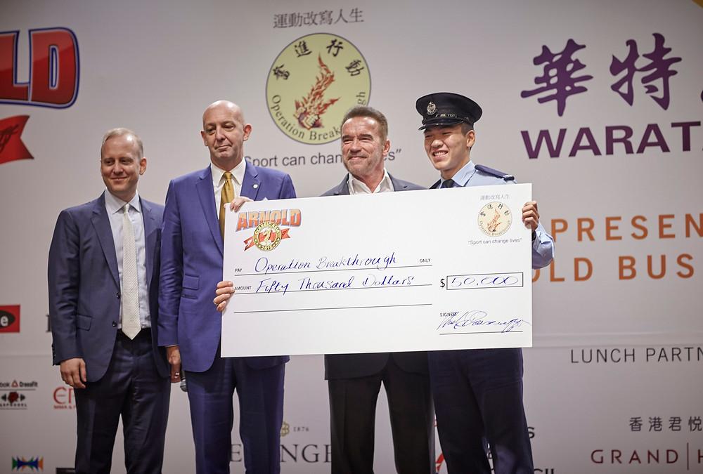 Operation Breakthrough Executive Director Glenn O'Neil presented with a HK $50,000 dollar cheque by Mr. Arnold Schwarzenegger