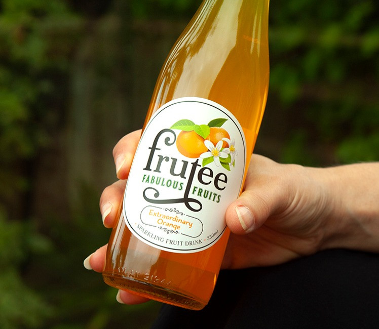 Frutee%20in%20hand_edited.jpg