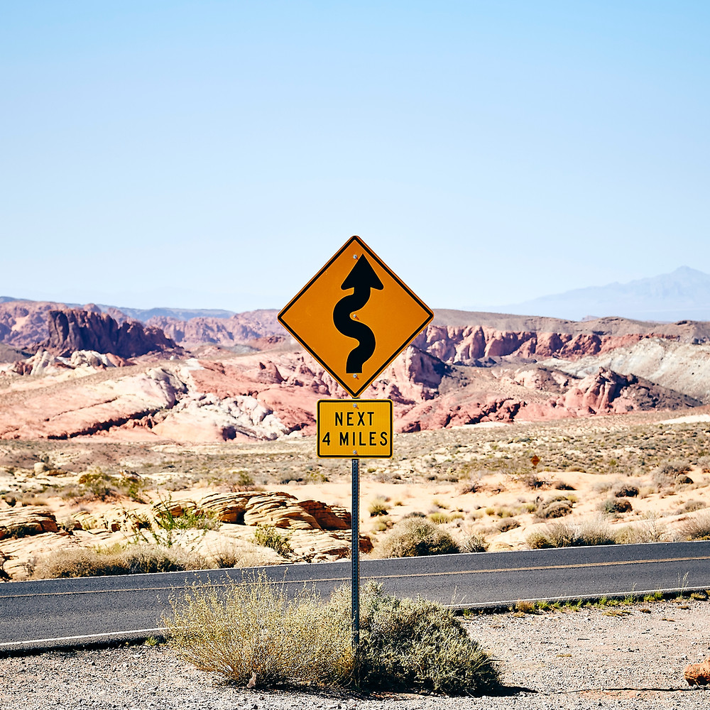 Winding roads ahead sign.