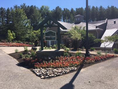 Ridge Club sign garden.JPG