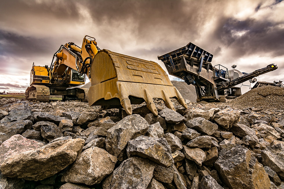 Excavator and machinery in an outdoor mi