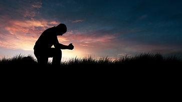 4-26-CH-Silhouette-of-man-kneeling-in-pr