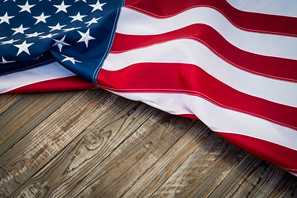 american-flag-dark-wooden-table_1232-101