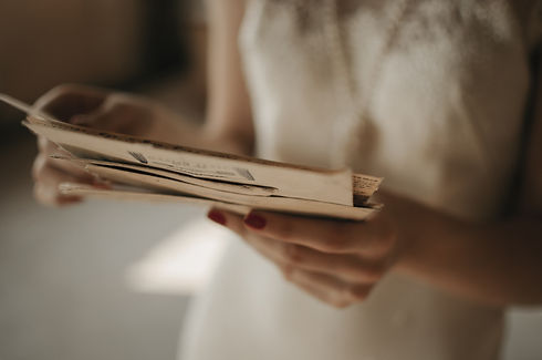 A girl holding a stack of old letters..j