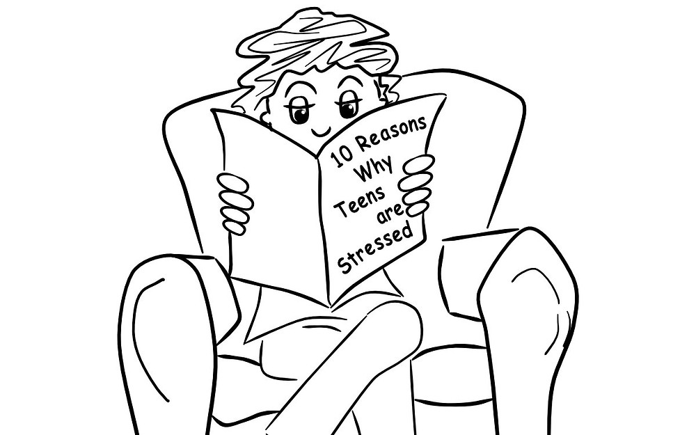 kid reading about the top 10 reasons teens are stressed
