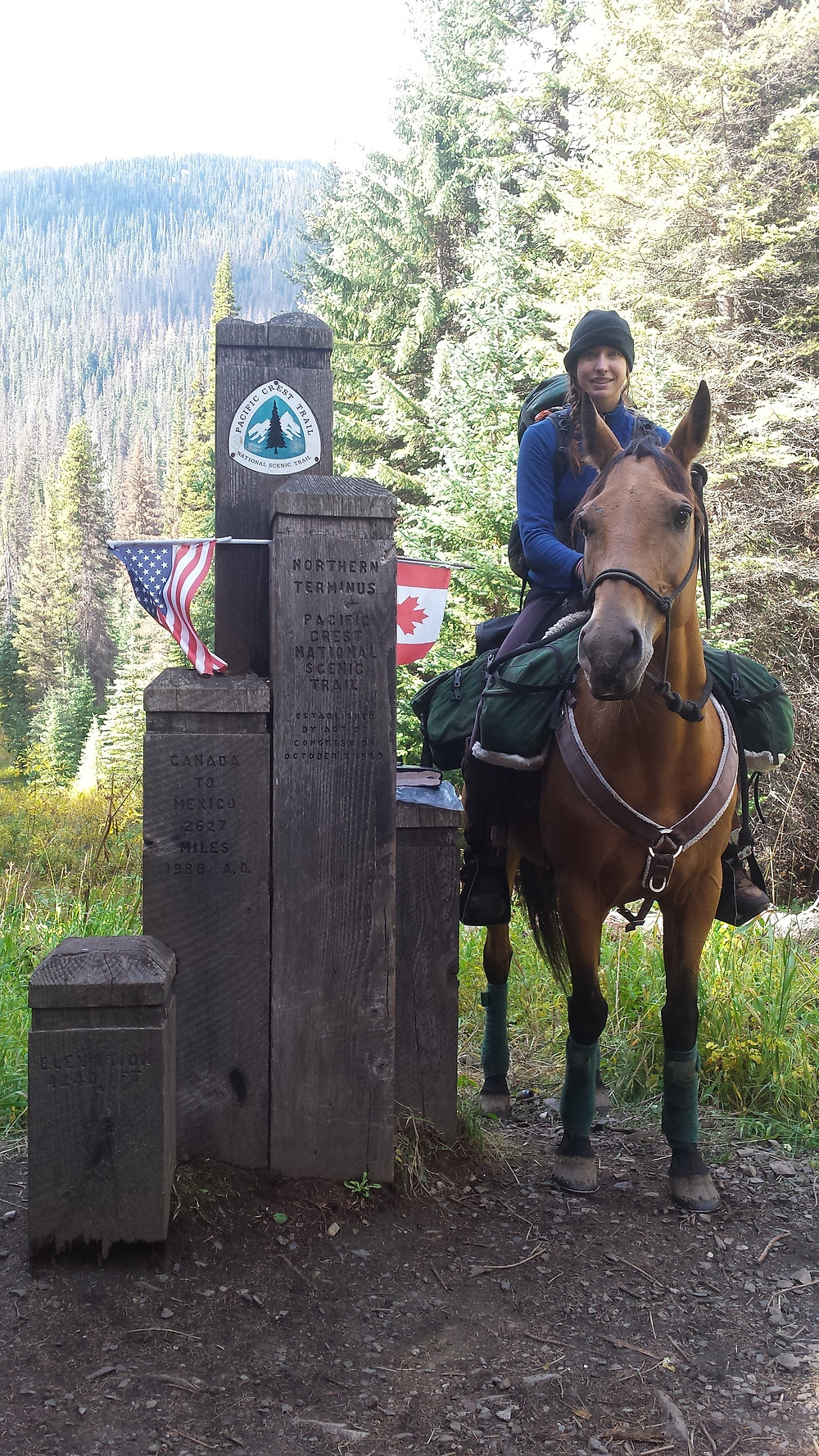 Gillian Larson and Shyla at the northern terminus of the PCT