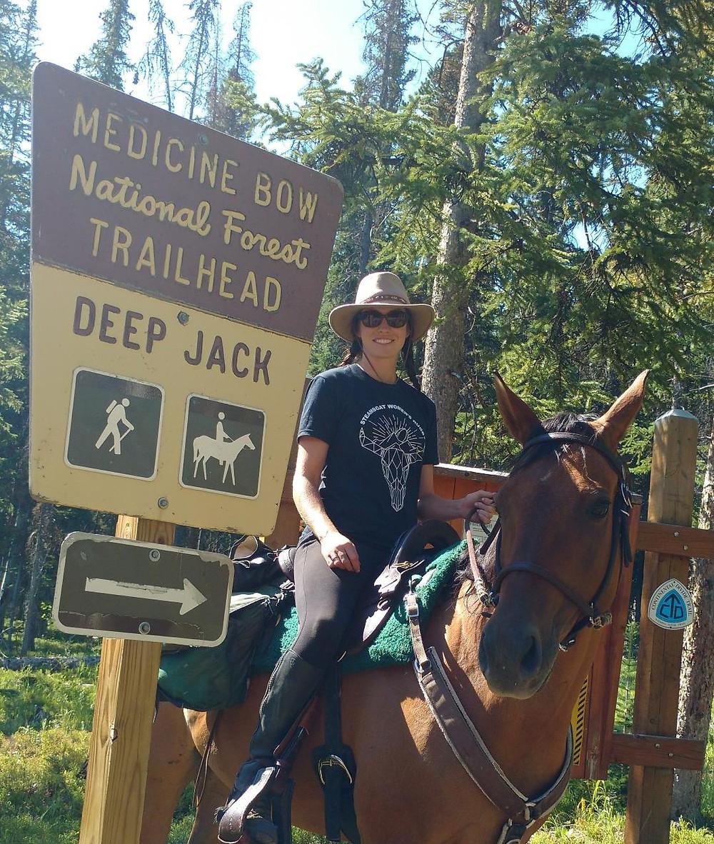 Gillain and Takoda ride out of Deep Jack trailhead