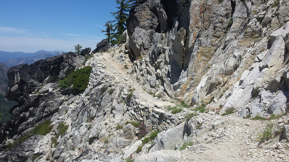 A narrow thread of trail along the rocks