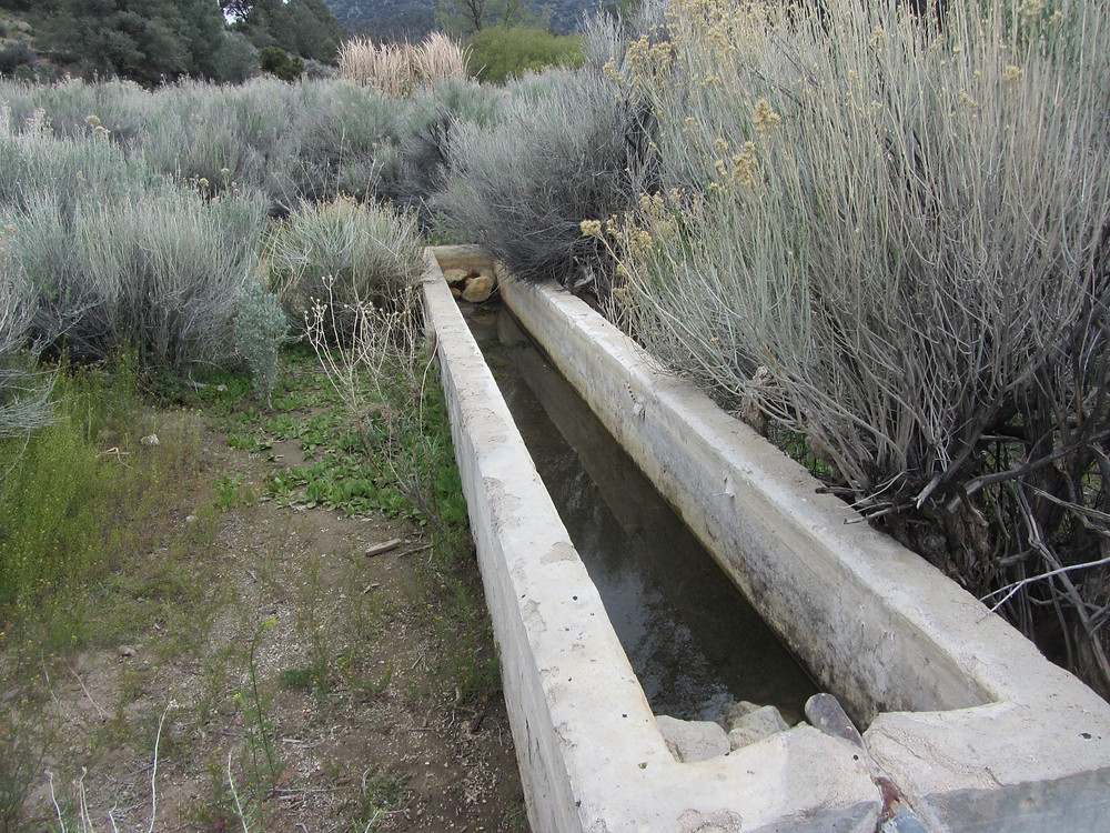large square trough with overflow pipe