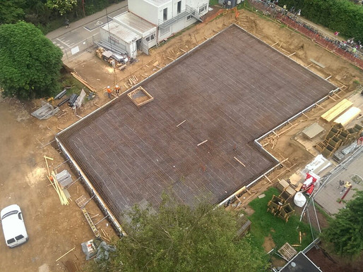 Update bouwwerken: vloerplaat Blok B en luchtfoto's werf