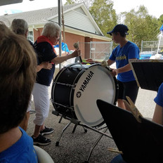 Marian was rarin' to go on the bass drum, her instrument back in the day