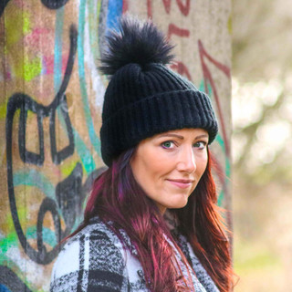 Urban outdoor portrait shot. Great to pick out the colours of the graffiti in the background.