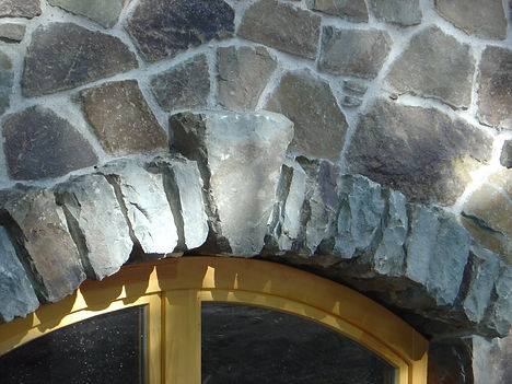 Blue stone wall construction with custom made window