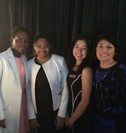 Janet Ferone with actress Lupita N'yongo and students