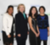 Janet Ferone with students and Hillary Clinton