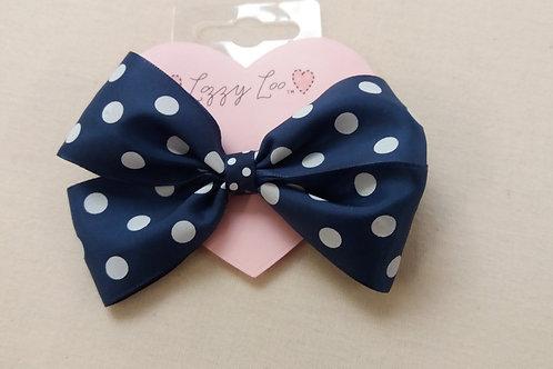 Navy polka dot pinwheel bow (BNPW)