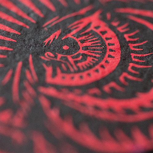 Black eye on red paper