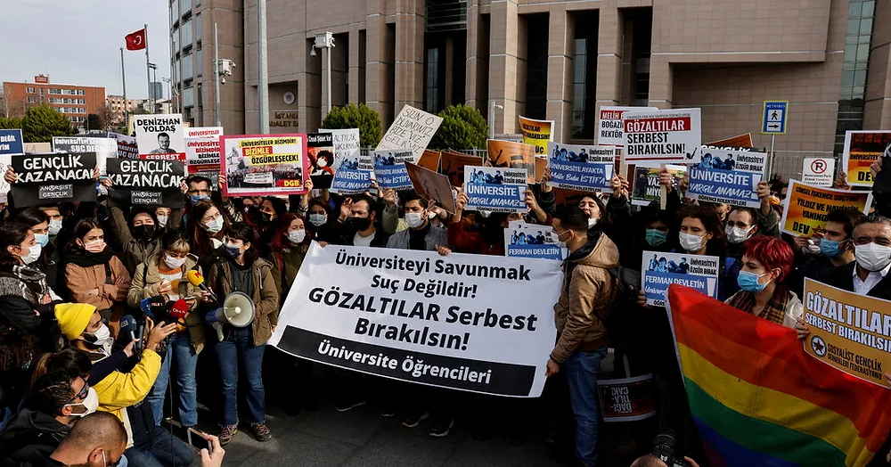 "Students of Bogazici University demonstrate outside a court as they demand the release of their fellow college students who are on trial for protesting against President Tayyip Erdogan's appointment of a new rector in Istanbul, Turkey, January 7, 2021. Banner front reads, ""Defending the university is not a crime! Release the detainees!"""
