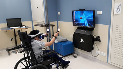 Boy in wheelchair using VR mask and hand