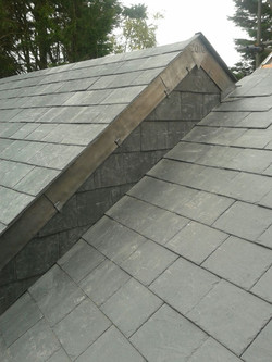 Natural slate roofing & Lead detail