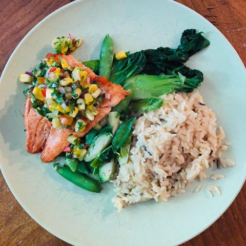 Pan-seared trout with greens and wild rice