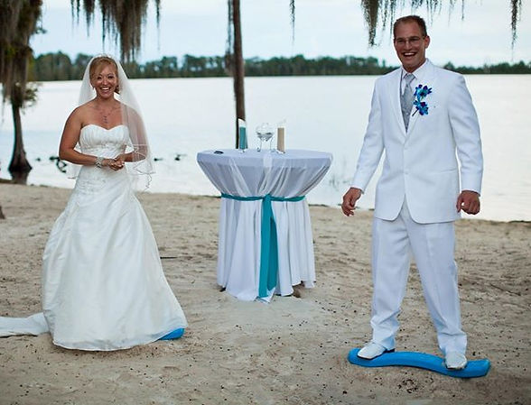 Company owners, bride and groom, beach wedding