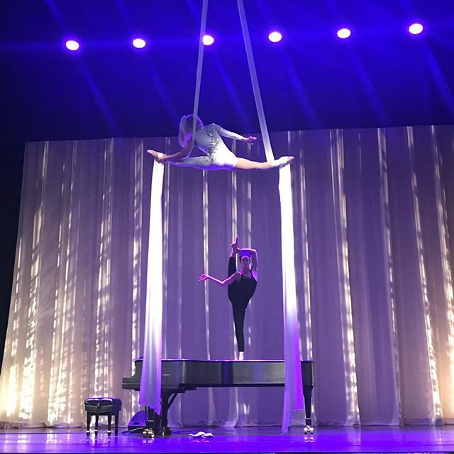 Aerialist and contortionist in theater on stage