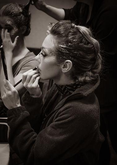 putting on makeup, pre-show prep
