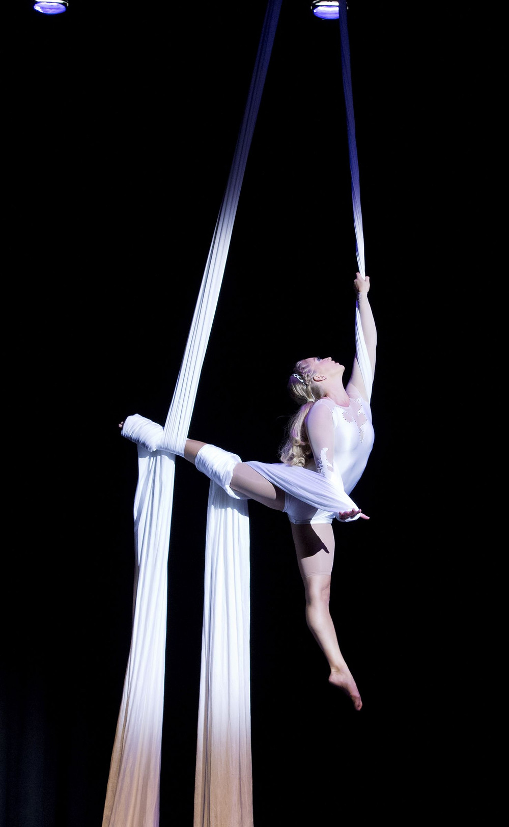 Aerial silks performer, Aerial Cheryl, aerialist in arabesque