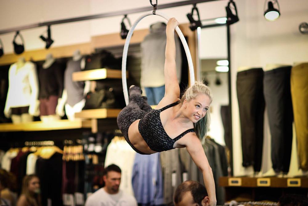 Aerial lyra performance, aerialist in hoop