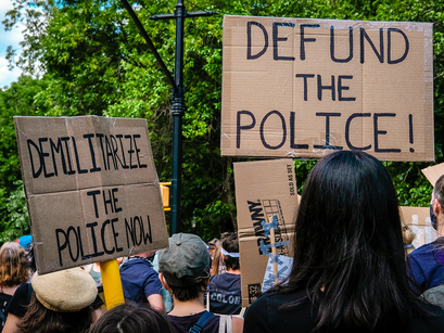For racial justice advocates, 'Defund Police' remains central rallying cry