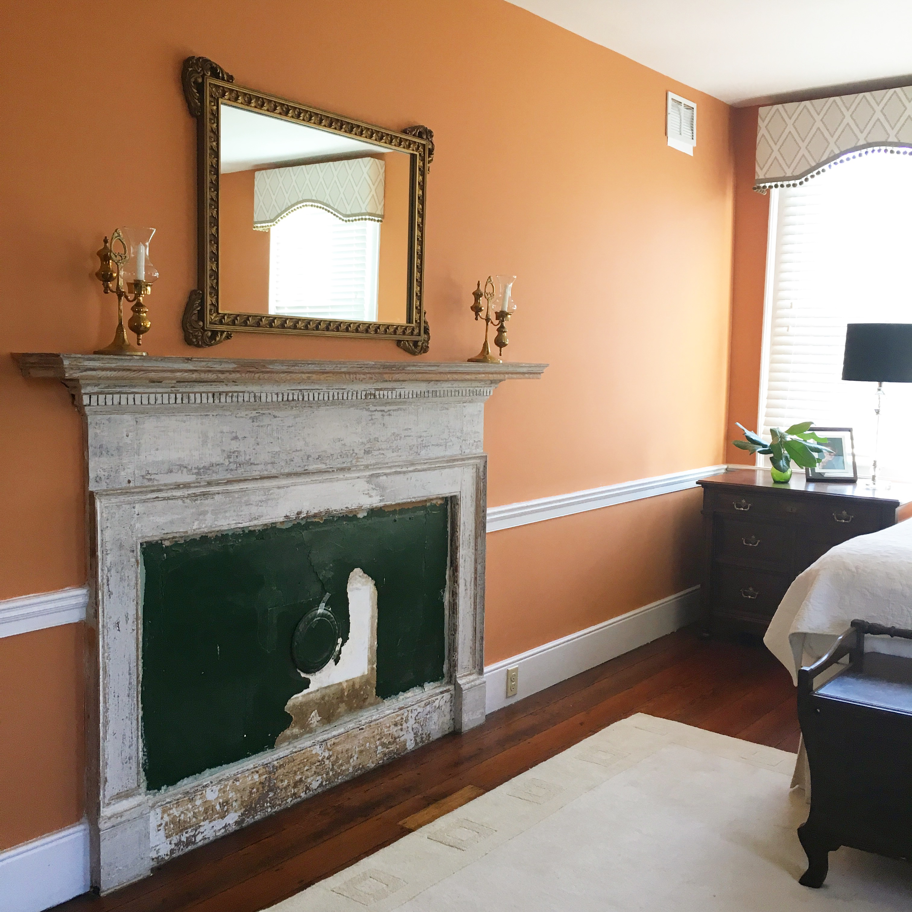 Historic renovation, original fireplace was left as a modern art piece