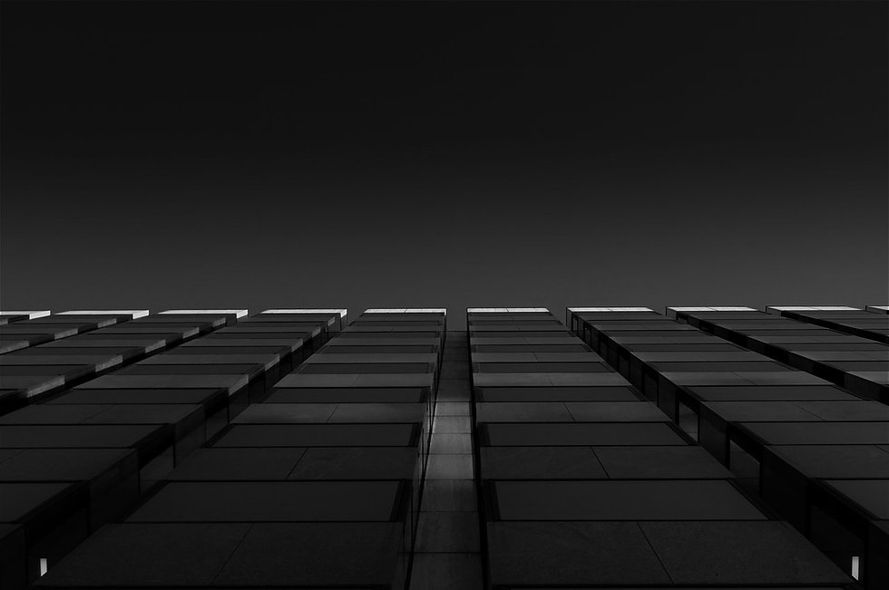 grayscale-photo-of-high-rise-building-11