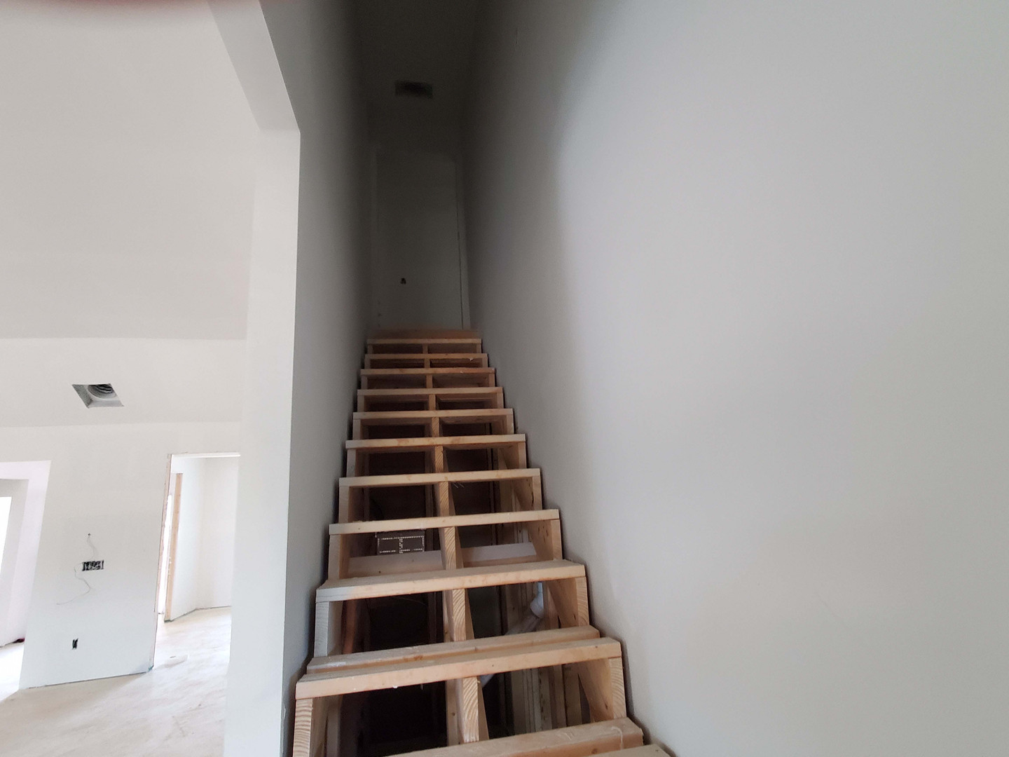 Stairs up to bedroom/bath over garage