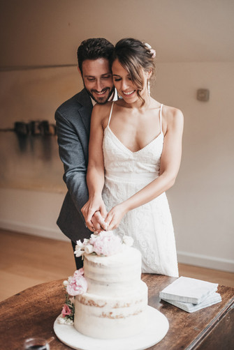 Cutting Cake Wedding Photography In Manc