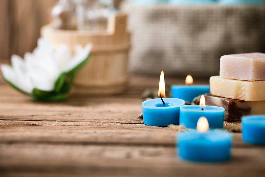 Spa and wellness setting with flowers and towels.jpg