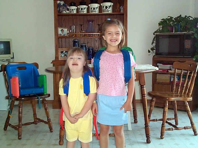Gabby & I off to school as kids