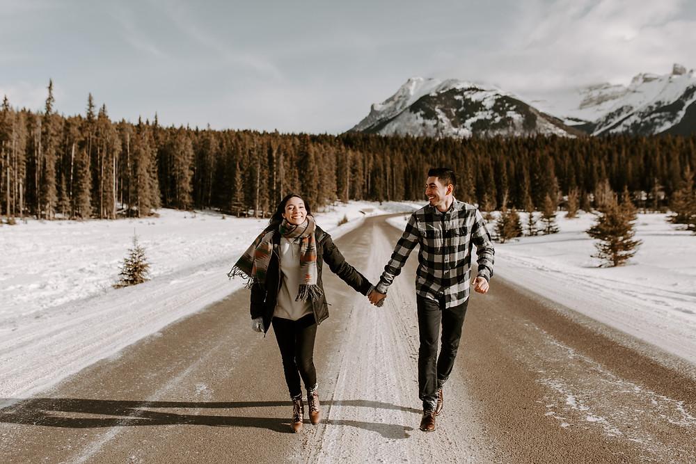 couple running lake minnewanka