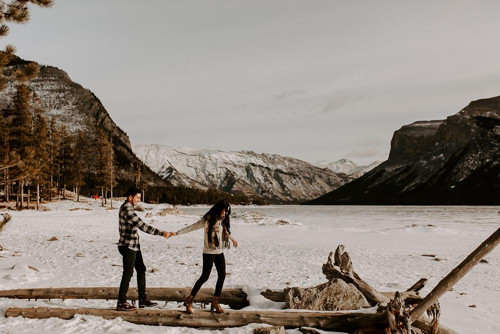 couple walking lake minnewanka banff