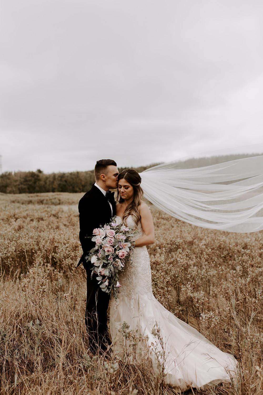 bride and groom meadow muse wedding