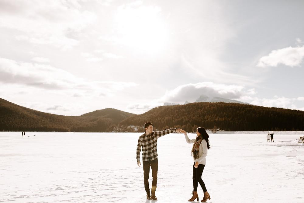 couple skating lake minnewanka banff