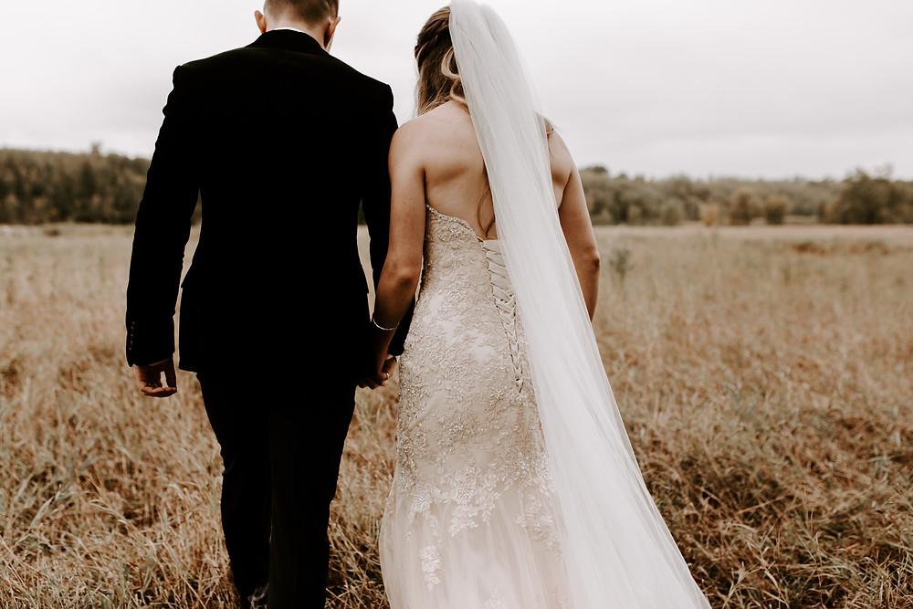 bride and groom walking in Fish Creek Park wedding