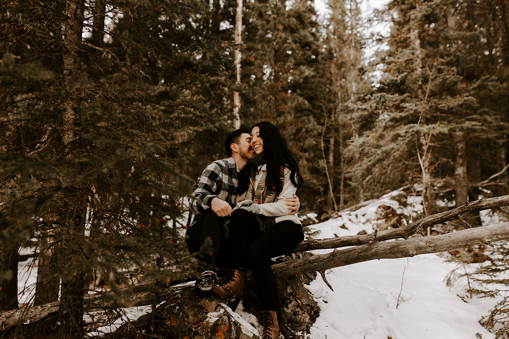 couple whispering lake minnewanka