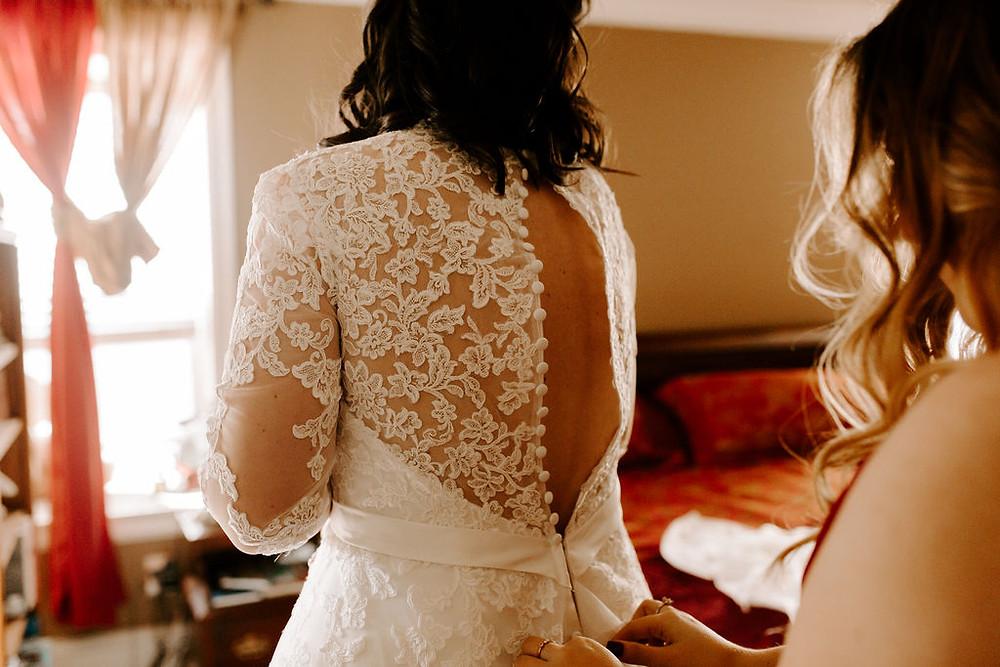 putting on wedding dress port kells church wedding