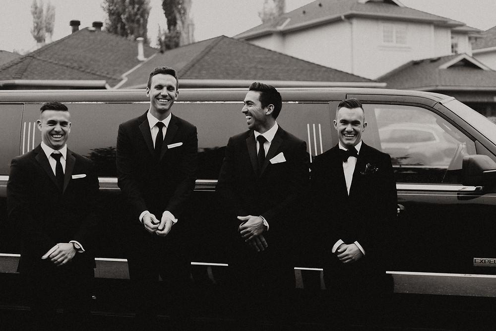 calgary wedding groomsmen standing by limo