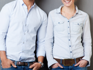 Why do men's and women's shirts have buttons on opposite sides?