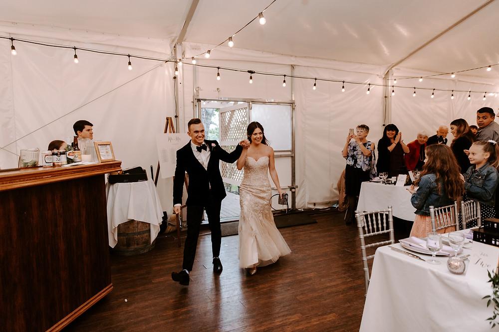 bride and groom entrance meadow muse pavilion wedding