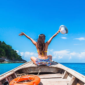 Happy woman traveler in bikini relaxing