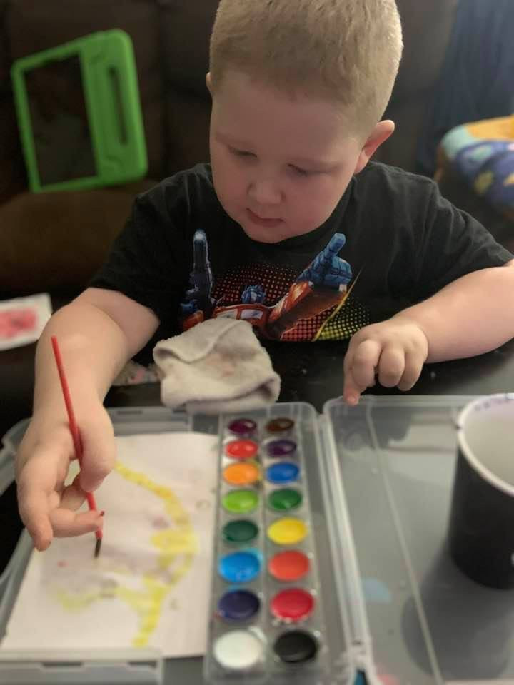 He loves to paint!